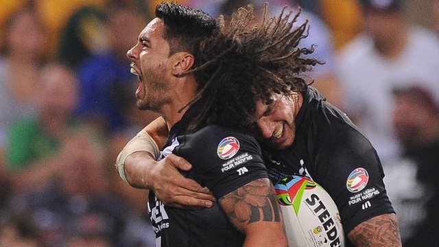 New Zealand's Shaun Johnson (l) celebrates scoring a try with Kevin Proctor