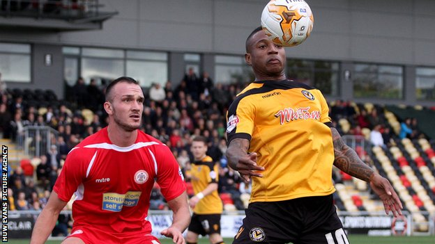 Newport County's Aaron O'Connor is closely eatched by Tom Aldred