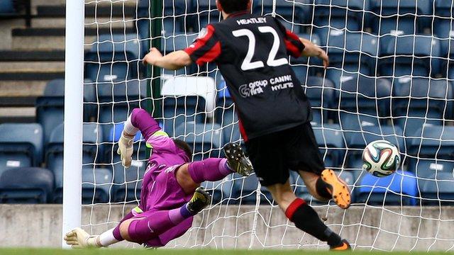 Crusaders Paul Heatley celebrates as Colin Coates free-kick beats Linfield goalkeeper Johnny Tuffey at Windsor Park