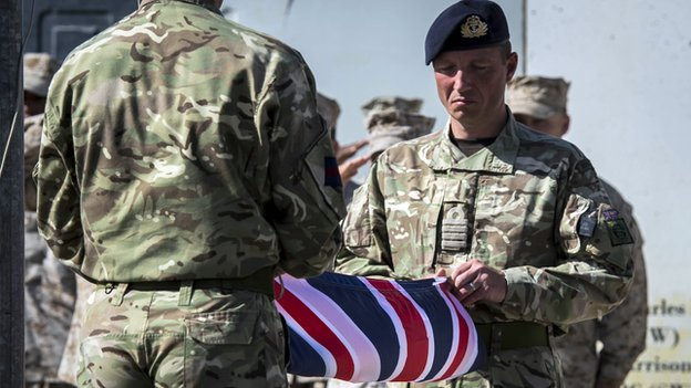 Two British soldiers hold a union jack