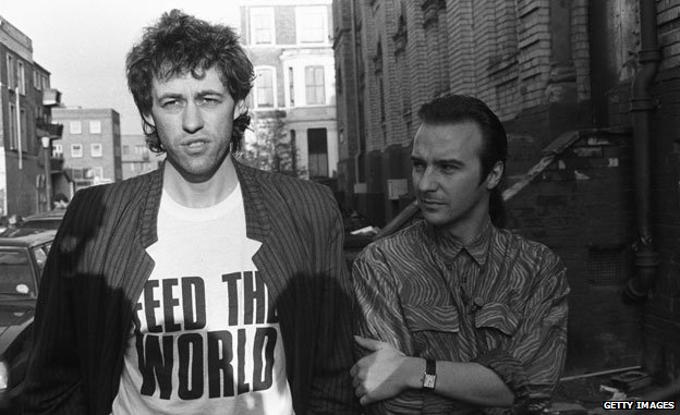 Bob Geldof and Midge Ure outside SARM Studios in Notting Hill, London, during the recording of the Band Aid single Do They Know It's Christmas?