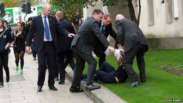 Man surrounded by police offers after running into David Cameron