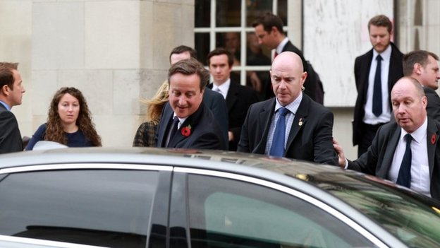 Mr Cameron entering his car after the incident