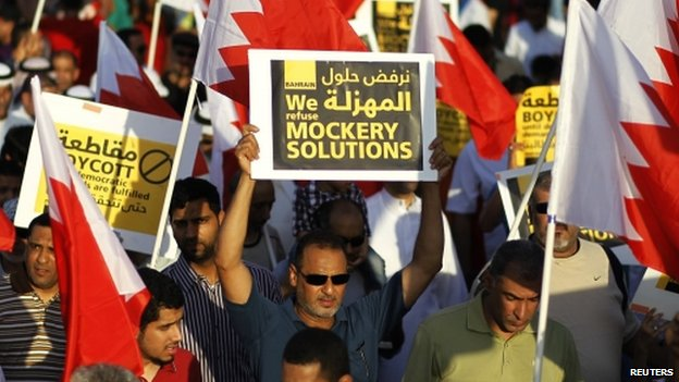 Protesters march during a rally in Budaiya, west of Manama, Bahrain on 19 September 2014
