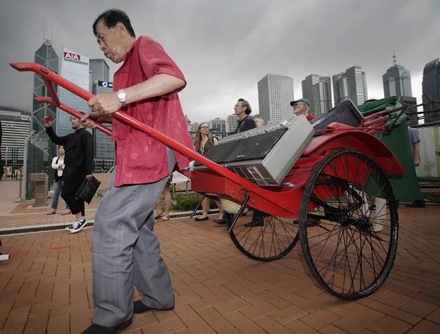 Man pulling rickshaw in Hong Kong