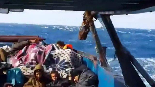 Migrants on boat on Mediterranean