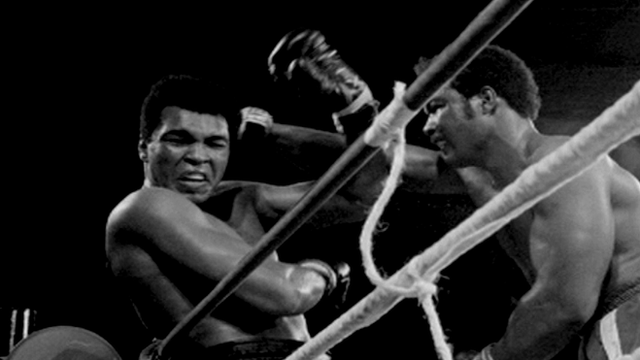 Muhammad Ali and George Foreman contest The Rumble in the Jungle