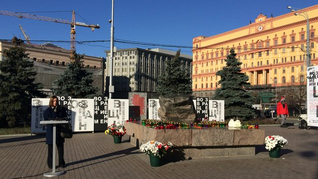 A woman gives a speech at the memorial for victims of political repression in Moscow