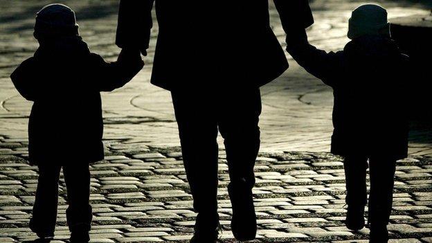 Silhouette parent and children