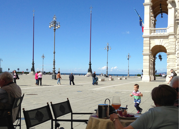 A child plays near the seafront in Trieste