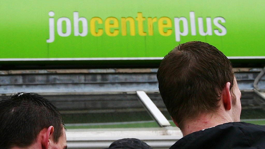 People standing outside a Job Centre in the United Kingdom
