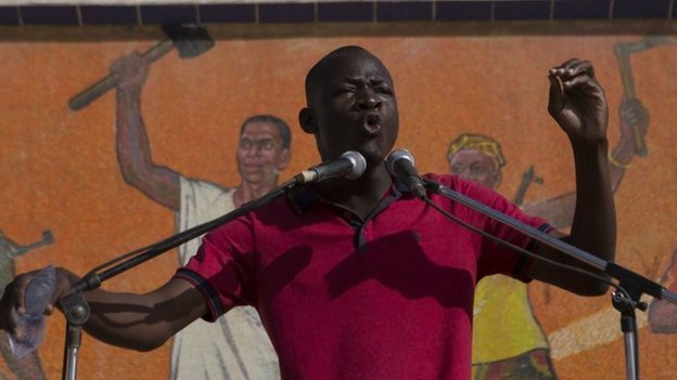 A youth protest leader speaks to the crowd gathered at Place de la Nation in Ouagadougou, capital of Burkina Faso, November 2