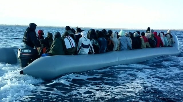 Migrants in boat in May - handout from Libyan coastguard
