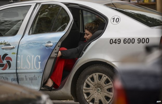 Maria Bamieh leaves a taxi in Pristina (31 Oct)