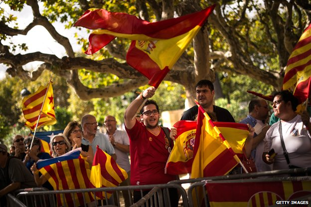 Pro-independence and anti-separatist demonstrators shout slogans outside the Catalan Parliament on September 19, 2014 in Barcelona, Spain.