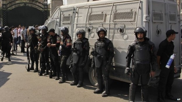 Egyptian security forces stand guard at Cairo University in Cairo, Egypt, on 12 October 2014
