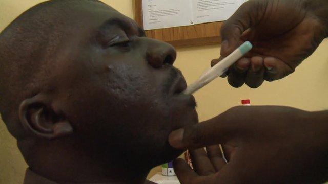 Man having temperature taken