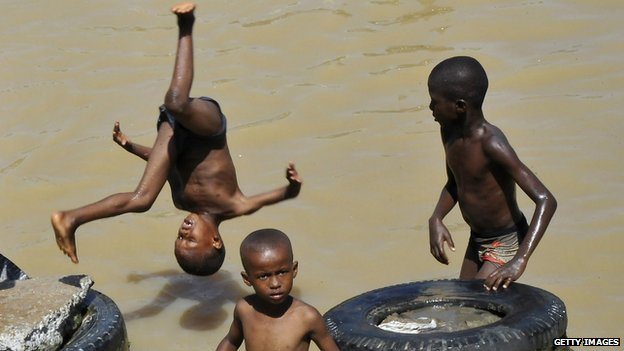 Boys playing in Ebrie Lagoon