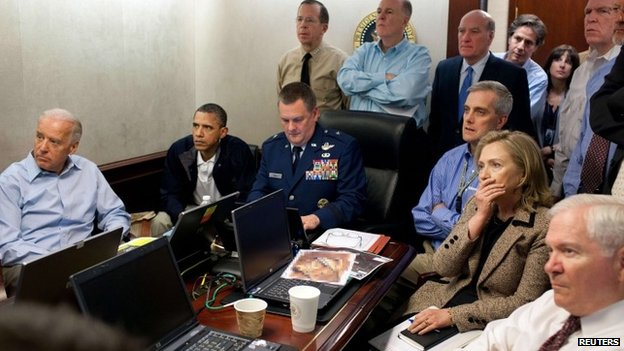 US President Barack Obama (2nd L) and Vice President Joe Biden (L), along with members of the national security team, receive an update on the mission against Osama bin Laden in the Situation Room of the White House 1 May 2011