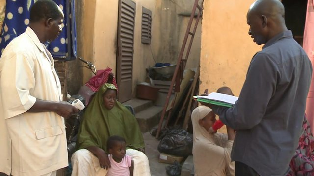 Health workers assessing quarantined patients