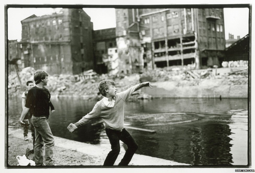 Lad throwing rock into Leeds-Liverpool canal