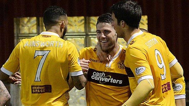 Iain Vigurs (centre) celebrates scoring for Motherwell