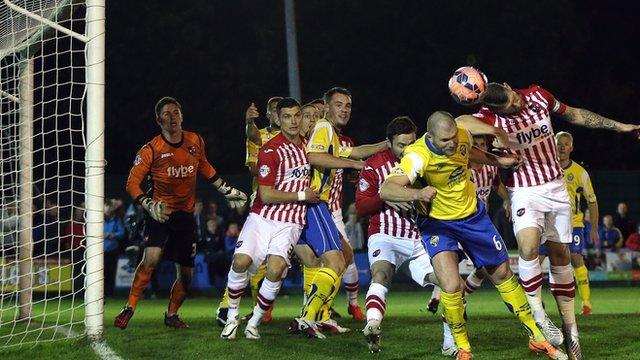 Warrington Town's Craig Robinson heads his side into the lead