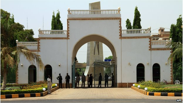 Sudanese security guards stand at the gate of the presidential palace in Khartoum in 2010