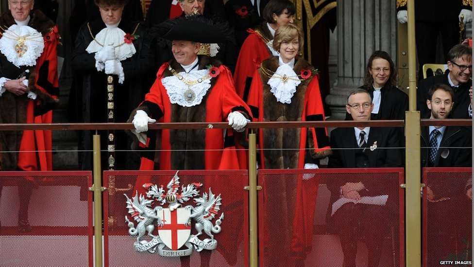 Alan Yarrow, the new Lord Mayor Of London and Fiona Woolf, the previous Lord Mayor, greet the crowd during the annual Lord Mayors Show