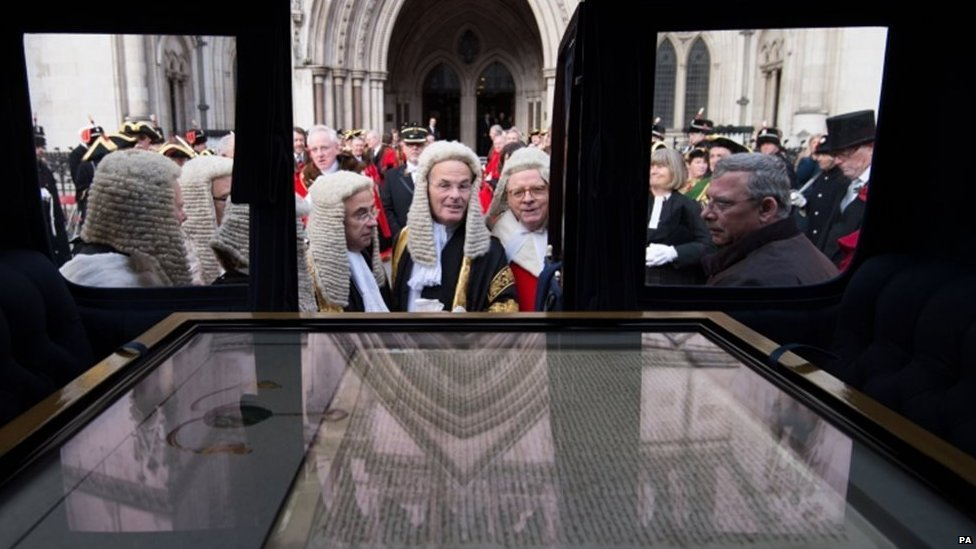 """Judges look at the City of London""""s 1297 Magna Carta as it travels through the City of London as part of the Lord Mayors Show"""