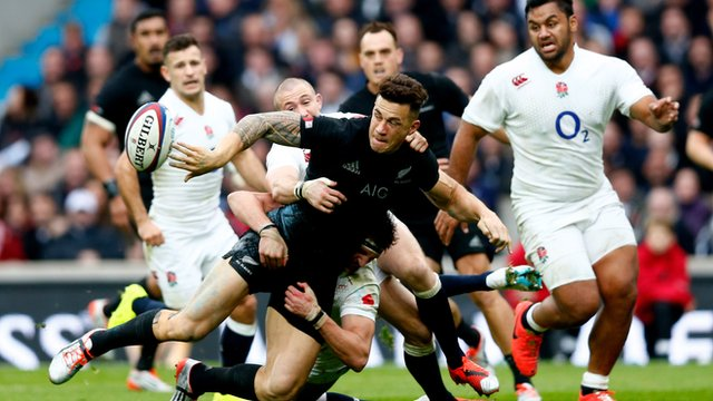 New Zealand's Sonny Bill Williams is tackled by England players during their autumn international match at Twickenham