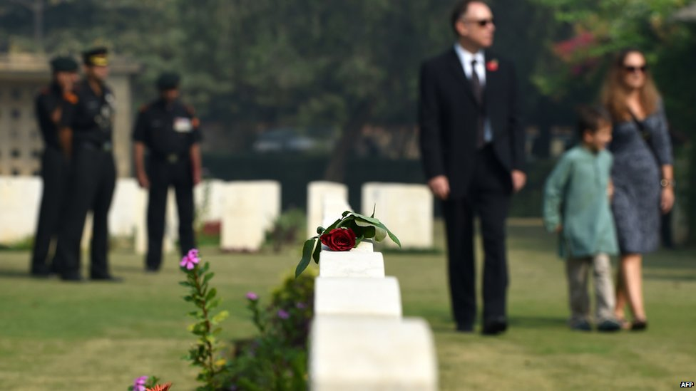 A rose lies on a tombstone at Delhi War Cemetery in New Delhi on November 9