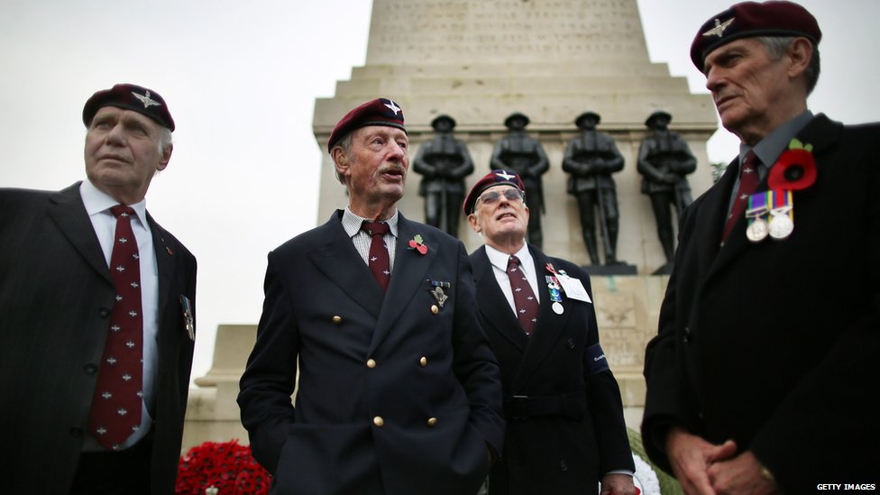 Veteran members of the Guards Parachute Company Pathfinders stand by the Guards Memorial in Horse Guards