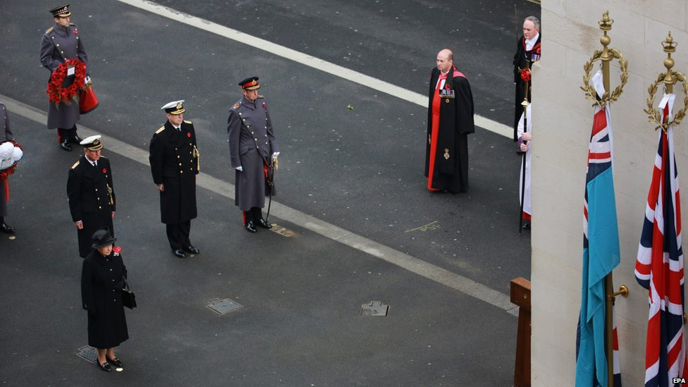 Queen Elizabeth II (L) leading the Remembrance Sunday service