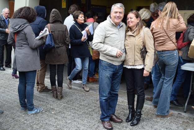 Husband and wife Cesar Saiz Lilian Subietas after voting at the CIC high school polling station in Barcelona, 9 November