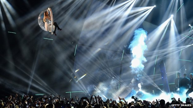 Ariana Grande flying above the crowd