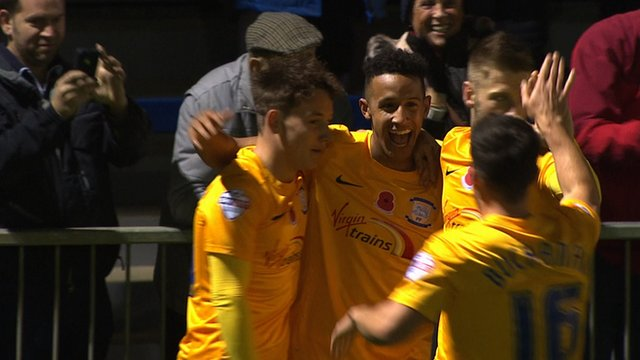 Callum Robinson fires in from a tight angle to give Preston an early lead against Havant & Waterlooville in the FA Cup first round.