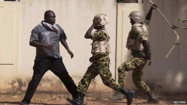 Lassina Sawadogo confronts soldiers in Ouagadougou, capital of Burkina Faso, on 30 October 2014