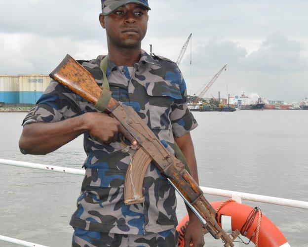 An armed officer on board a Nimasa boat, Nigeria