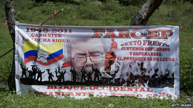 A billboards praising the late Farc leader Alfonso Cano is seen in the road between Caloto and Toribio on 7 November, 2014