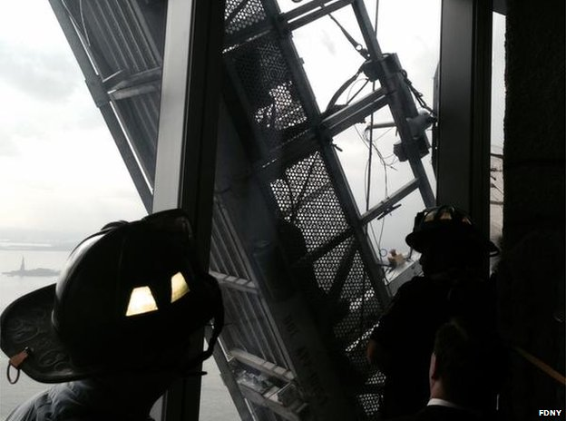 Firefighters attempt to save window washers
