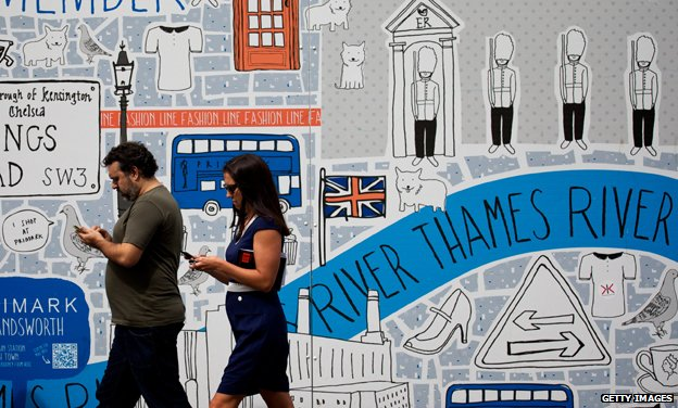 Pedestrians using smartphones on a London street