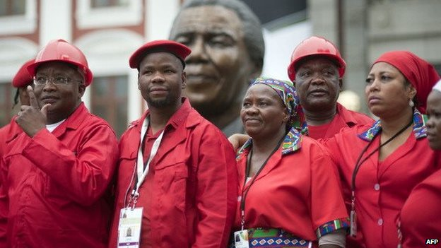 Members of the Economic Freedom Fighters(EFF) pose for a photo in front a bust of Nelson Mandela at the South African parliament, Cape Town, South Africa - May 2014