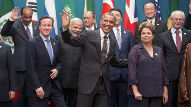 US President Barack Obama, centre, and Brazilian President Dilma Rousseff, right, walk off stage with other world leaders after the G20 Summit family photo in Brisbane, Australia, on 15 November 2014