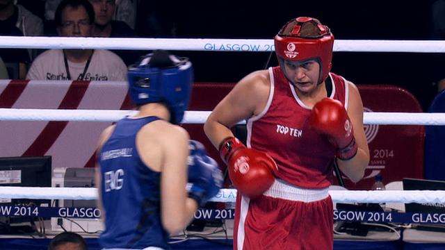 Should women boxers remove headguards?