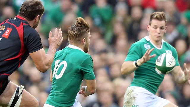 Ian Madigan passes the ball to Ireland team-mate Craig Gilroy during the match against Georgia