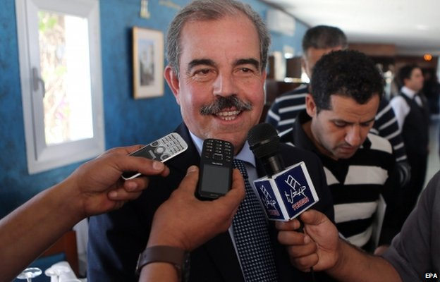 Former Tunisian Health Minister and presidential candidate Mohamed Mondher Zeneidi (L) speaks to media during presidential electoral campaign in Bizerte north of Tunis, Tunisia, 04 November 2014.