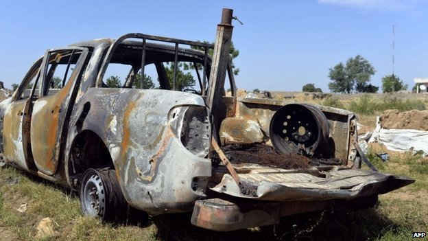A destroyed vehicle outside a military post in Amchide, Cameroon (15 November 2014)