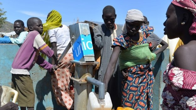 People collect water from a pump on 13 November 2014 in a UNHCR camp for Nigerian refugees in Minawao, in the extreme north-west of Cameroon