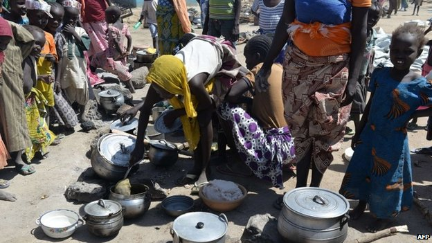 Women prepare food on 13 November 2014 in a camp for Nigerian refugees in Minawao, in the extreme north-west of Cameroon